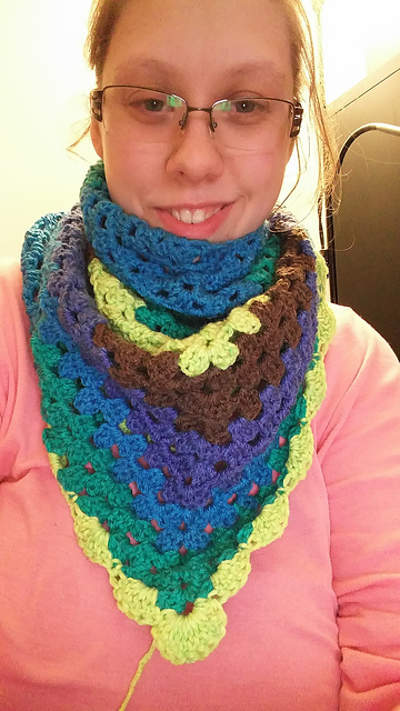 Ashlee brought in her Happy Go Lucky Shawlette by Jennifer Dickerson in Caron Cakes