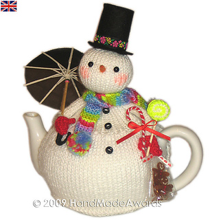 Ravelry: Christmas Snowman with Umbrella Tea Cosy pattern by Loly Fuertes
