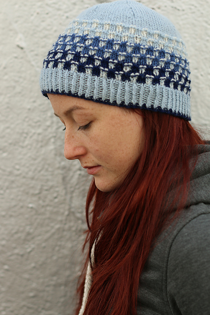Handknit hat in cool tone gradient yarns, pattern by Carol Feller.