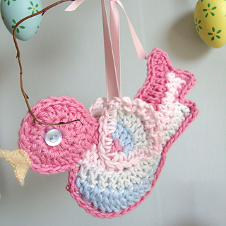 Pink-bird-with-eggs-close-up-square_small2