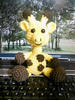 Babygiraffesitting_small2