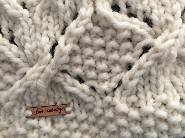 knitting with custom tag that says