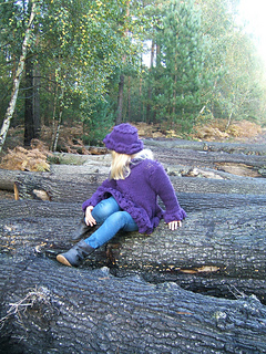 Beth_blueberry_sweater_sitting_on_log_looking_to_side_shot_small2