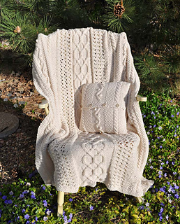 Fisherman_afghan_pillow_on_rocking_chair_outside_small2