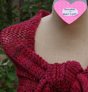 Dorable_with_heart_label_wrapped_as_shawl_knot_in_front_showing_right_shoulder__small2