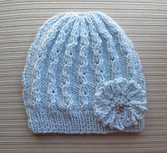 Blue_lacy_hat_with_a_crochet_flower_for_a_lady_small