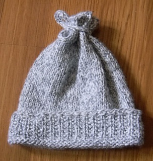 Ravelry: Mistake Rib Baby Hat pattern by Compile Yarn