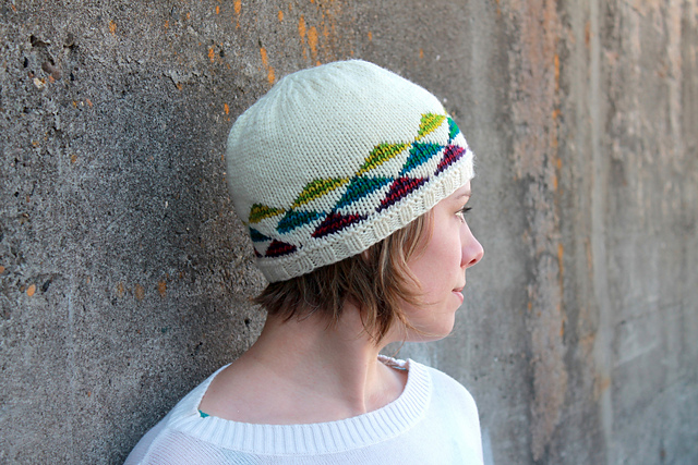 woman wearing knit hat with colorful triangles on it