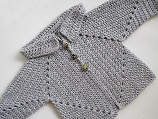 156fc3c0502c Ravelry  Sue s No holes Hexagon Baby Sweater pattern by Susan A. Coes