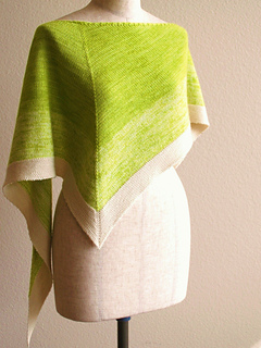 Graduated kerchief knitted triangle scarf in shades of lime green and off white.