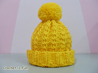 Ravelry  loom knit cable hat pattern by Amani Amani da8d2eadce9