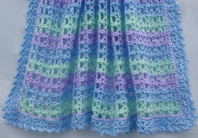 Ravelry: Striped Lace Crochet Baby Blanket pattern by Amy Solovay