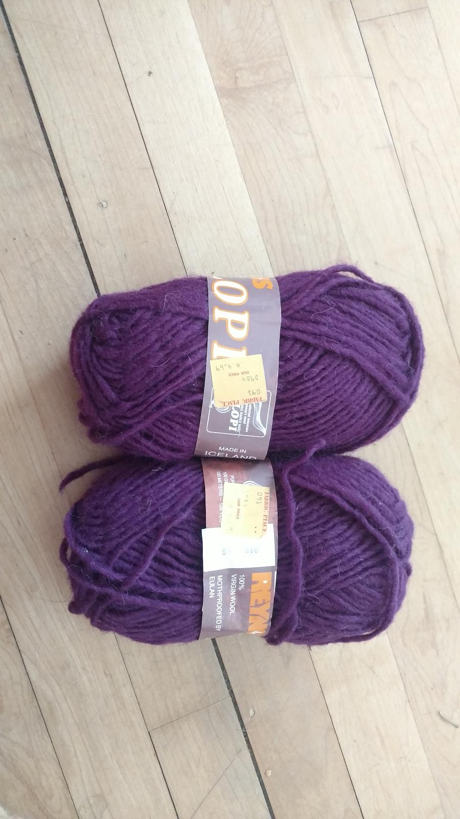 two skeins of plum purple yarn