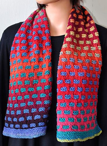 Bright brick mosaic pattern on knitted scarf.