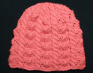 daac40dd5c7 Ravelry  Faceted Lace and Cables Baby Hat for Straight Needles pattern by  Heather Tucker