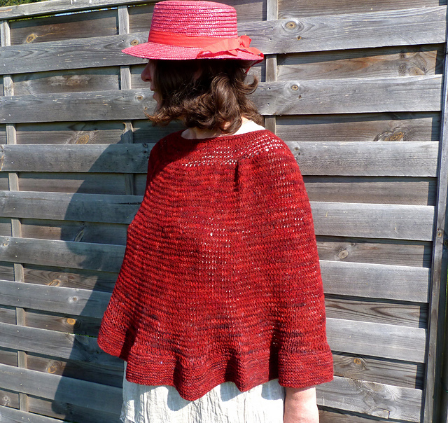 Plain and simple knitting pattern for poncho in red yarn.