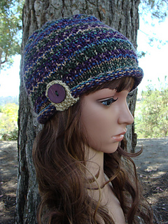 9123c2ce6a7 Ravelry  Roll-up Brim Knit Hat with button and strap pattern by Mary Legere