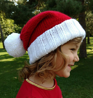 a0f75b7ae65 Ravelry  Santa fold up brim Knit Hat with Pom-Pom pattern by Mary Legere