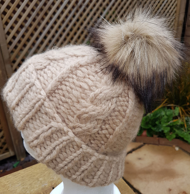 https://www.ravelry.com/patterns/library/cosy-cables-bobble-hat