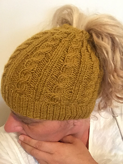 826ad4e6e1d7d Ravelry  Cabled Messy Bun Hat pattern by The Knit Guru
