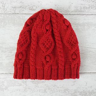 de187542ca9 Ravelry  Diamond Cable Hat pattern by Juliet Bernard