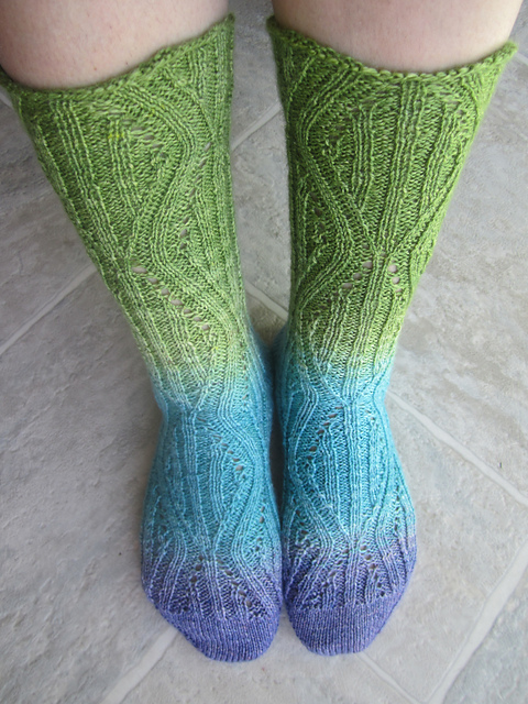 Handknit socks in a grandient yarn. Pattern by Carol Feller