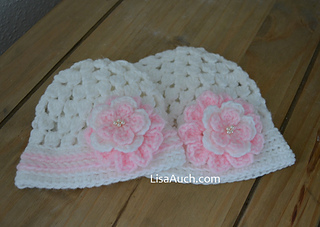 2a89c1451 Cluster Stitch Baby Beanie with Flower pattern by LisaAuch