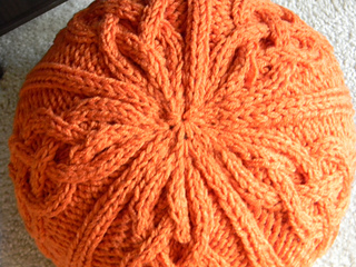 Ravelry: chunky cable knit pouf pattern by Theresa Boyce