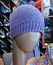 Purple_hat_on_table_model_small-1_small_best_fit