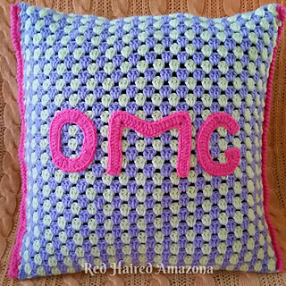 Omg_crochet_cushion_pattern_-_red_haired_amazona_small2