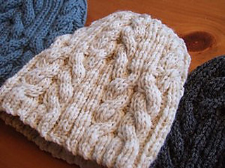 fe60c83e9f3 Ravelry  Utopia Cable Hat pattern by SmarieK