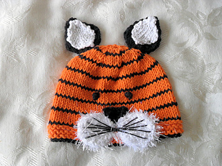 b3cf706a1a8 Ravelry  Knitted Tiger Baby Hat-Animal hat pattern by Susan Gardner