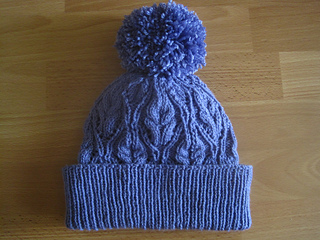 bf3b3b25327 Ravelry  Lydia Lace   Cable Beanie pattern by Suzie Sparkles