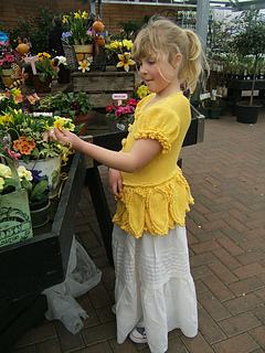 Beth_daffodil_cardigan_looking_at_primroses_small2