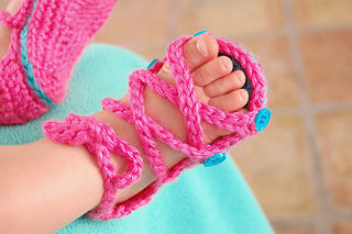 f141ec0d1 Ravelry  Baby Button Gladiator Sandals pattern by Bethany Dearden