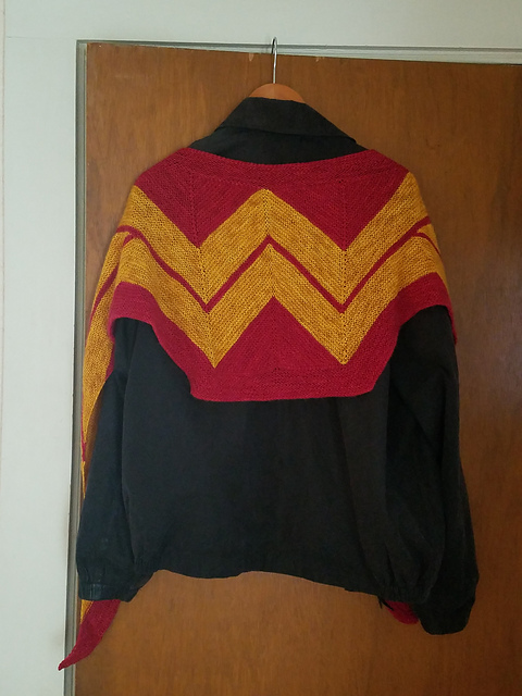 Wonder Woman red and gold shawl, draped over a black jacket