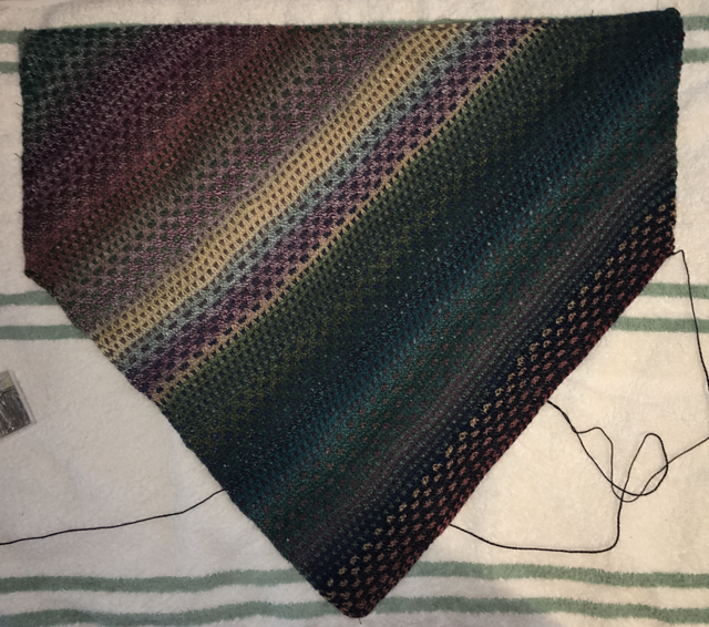 A diagonally knit cowl in color-shifting yarn