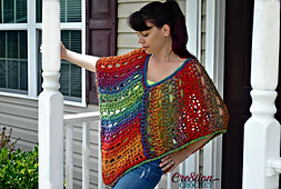Easy_lace_poncho__designed_with_unique_yarn_by_lion_brand