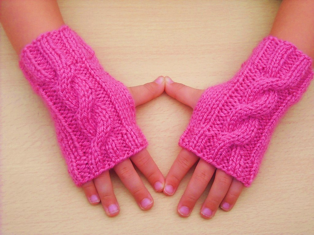 Ravelry: Children\'s Cable Knit Wrist Warmers pattern by Sandra Buckley