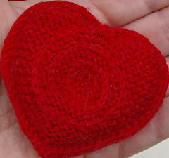 Single_heart_in_hand_close_up_resized_small