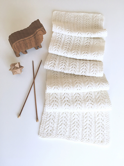 Beautiful ivory knitted scarf in delicate lace pattern.