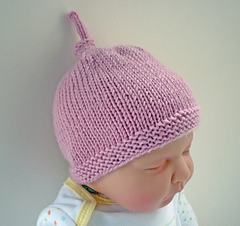 Ravelry  Baby Hat with Top Knot - Tegan pattern by Julie Taylor 807d94ed0a7