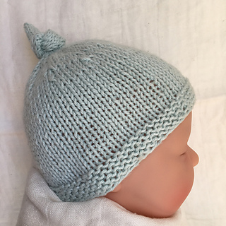 ad97eb539 Ravelry  Baby Hat with Top Knot - Tegan pattern by Julie Taylor