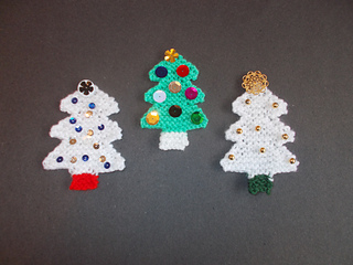 Ravelry: Little Knitted Christmas Tree Decorations pattern by marianna mel