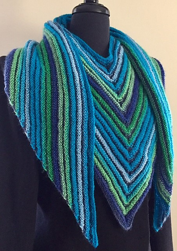 Colorful, knitted triangle scarf in bright stripes.