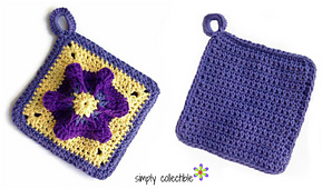 Penelope_s_pretty_petunia_potholder__free_crochet_pattern_on_simplycollectiblecrochet