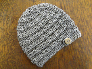 03cefad76b5 Ravelry  Beehive Button Slouchy Beanie pattern by Kathy Olivarez
