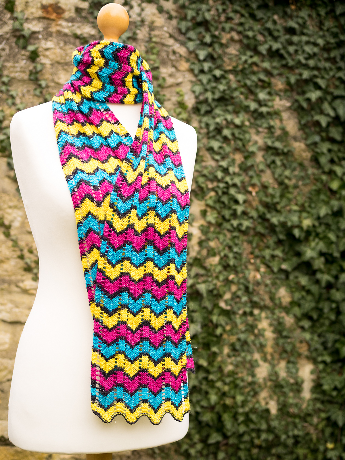 Colorful scarf knit with 1 skein of fingering weight yarn.
